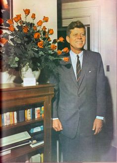 May29, 1963: President John F. Kennedy stands by a bouquet of 46 red roses on his 46th birthday.
