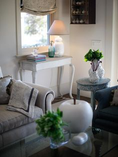 A weathered white console table with cabriole legs sets the tone in the entry of this casual California living room.
