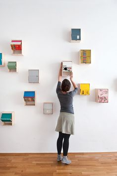 Turn Beautiful Book Covers Into Wall Art That Doubles As Storage