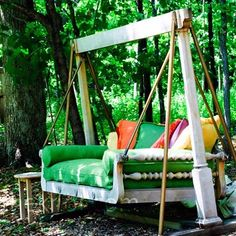 a swinging bed with fluffy colorful pillows!