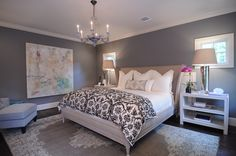Leslie Strauss / Matt Camron Antique Oushak rug and custom headboard and bedding.