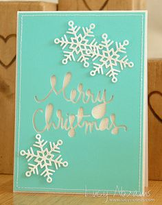 A sparkly Christmas card that uses some new Simon Says Stamp goodies—the Merry Christmas die, and the gorgeous Maryanne Snowflake.