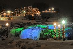 Falls Park in Sioux Falls, South Dakota is adorned with beautiful lights during holiday festivals each winter.