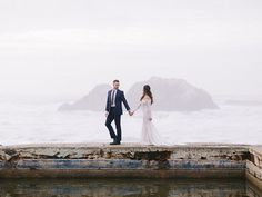 How perfectly overcast and moody was the weather for Angelina & Josh's wedding portraits at Sutro Baths?       #bride #weddingday #weddingdress #weddingphotography #bridal #weddinginspiration #weddingphotographer #sanfranciscoweddingphotographer #sanfranciscowedding #sutrobathswedding #smpweddings