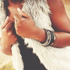 Bangles & fur vest. love