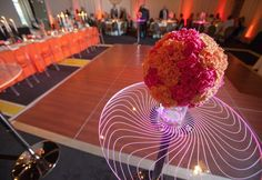 lighted cocktail tables with ball arrangement at pink and orange wedding