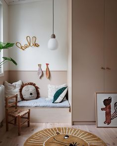 Cute kids bedroom with built-in wardrobe and little seat with Ferm Living accessories