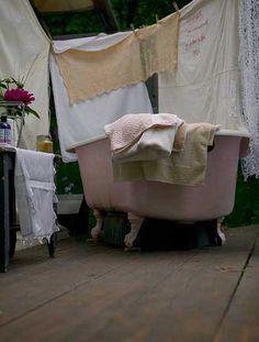 A farm, outdoor baths, pink tub, clawfoot tubs, bathtub, bathroom
