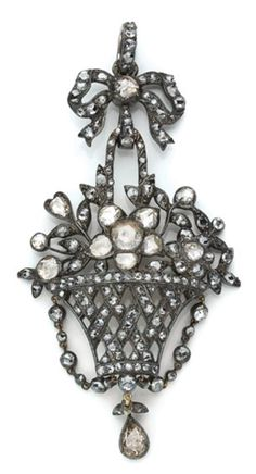 Antique Diamond Pendant   Silver, gold, the pendant topped by a bow centering one rose-cut diamond, suspending a basket overflowing with flowers, set throughout by numerous rose-cut diamonds, approximately 12.6 dwt. Victorian or Victorian style.