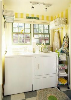 LOVE the yellow striped walls and green window trim!