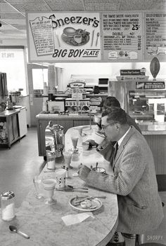 "1960. Green Bay, Wisconsin. ""Packers coach Vince Lombardi at lunch counter."" Sneezer's No. 2 -- could anything sound more appetizing? Photo by Frank Bauman for the Look magazine"