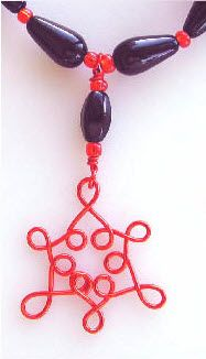 HOW A WIGJIG CAN HELP TAKE YOUR CREATIONS TO THE NEXT LEVEL at https://www.wigjig.com/blog/1818-how-a-wigjig-wire-jig-can-help-take-your-creations-to-the-next-level.  Super Halloween necklace.