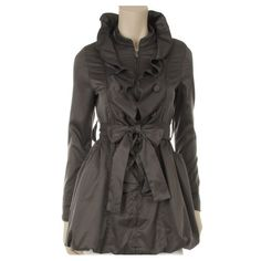 This stylish trench coat features ruffle trim...