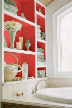 A shock of coral-red turns built-in bath storage into an artful tub-side display. | Azores Rose (B24-1),@Dutch Boy Paint