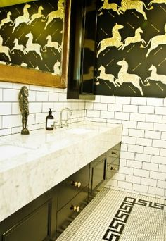Love this black and white bathroom. Subway tile and mosaic tile floor with a fretwork border! #TileSensations