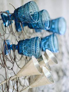 Keep old springs from an upholstered chair out of the landfill by turning the coils on end as an offbeat stemware organizer. The twisted wire is ideal for holding fluted glassware.