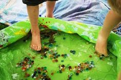 Game: picking up marbles with only your toes out of a kiddie pool... see how many they can get in a time limit