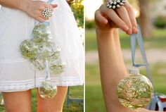 very interesting idea; fill clear ornaments with flowers/greenery