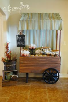 Adorable peddler's cart.  I can not express how much I love this!!  Change up the fabric on the top and it's a lemonade stand.  Add buckets of flowers and it's a flower stand.  Love!! How can I convince my husband to make one of these for me??