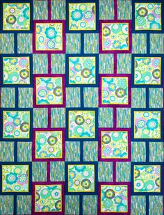 """Rain Flowers"" from Happy Stash Quilts is a great pattern for showcasing a large focal print. Directions are provided for quilt sizes crib through king."
