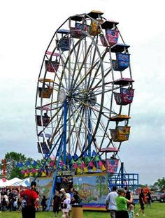 A ferris wheel gives passengers a scenic view of Lake Michigan during Milwaukee's Great Circus Parade Festival.