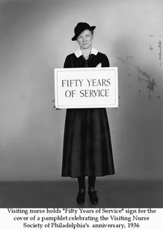 """Visiting nurse holds """"Fifty Years of Service"""" sign for the cover of a pamphlet celebrating the  Visiting Nurse Society of Philadelphia's anniversary, 1936. Image courtesy of the Barbara Bates Center for the Study of the History of Nursing."""