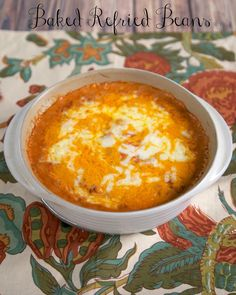 Baked Refried Beans serves 4     1 (16-oz) can refried beans     1/2 cup sour cream     1/2 cup salsa     1/2 cup shredded cheddar cheese   Preheat oven to 350.  Combine refried beans, sour cream and salsa. Spread in a 8x8 baking dish. Top with cheddar cheese.  Bake for 20 minutes, or until bubbly.