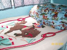 Interior of Lorri's retro trailer from Cute As Pie Cottage blog. Love the chenille bedspread.