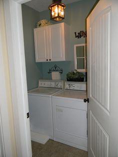 Tiny laundry room with no windows