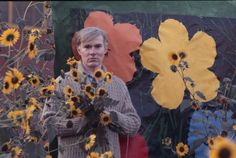BEFORE THEY WERE FAMOUS; Andy Warhol enjoying the photo shoot of his flower art work among the flowers. Article and slide show.  Free subscription.