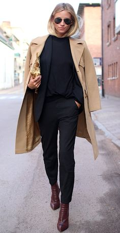 Street chic in all black with a camel trench coat.