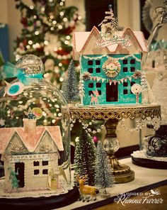 Christmas village as centerpieces with cake stands to accent pieces.