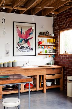 Love love love this kitchen. The brick, the natural light, the print, the color... <3