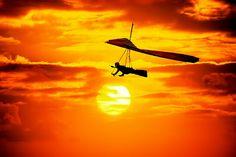 hang glide at sunset