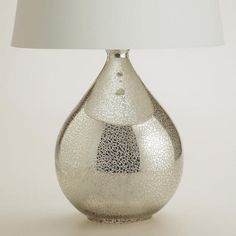 One of my favorite discoveries at WorldMarket.com: Martina Aged Mirror Table Lamp Base
