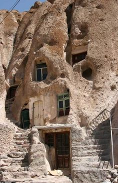Kandovan (Candovan) is a tourist village located near the city of Tabriz, in Iran. Legend says the first inhabitants of Kandovan moved here to escape from the invading mongols, They dug hideouts in the volcanic rock and ultimately ended up transforming them into permanent houses. It is now one of Iran's most popular tourist destinations and the rock-houses rival the famous Cappadocia Hotel.  Read more at http://www.odditycentral.com/travel/kandovan-the-stone-village.html#5fAKaBGbBPvbL7q0.99
