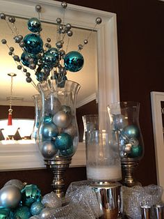 "Silver, white, and aqua blue Christmas decoration....prev pinner got her items at: The ornaments are from Target and the ""stuff"" coming out of the candle holders is from Hobby Lobby....."