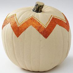 Glittered Chevron Pumpkin    Use sparkly ribbon for this chevron pumpkin. Cut lengths to make a zigzag line around the top of your pumpkin, then attach with spray adhesive. Press adhesive gems above the ribbon for embellishment.