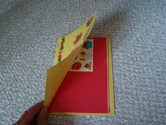 Blank paper is stapled inside of construction paper.  Stickers placed inside also with paper clip. Children can color pictures inside their book.