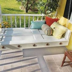 Daybed swing made from an old door.