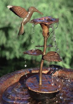 Hummingbirds can't bathe in normal birdbaths, but will often seek out moving fountains and sprays. This Hummingbird Dripper Fountain from Duncraft can be added to your traditional birdbath to attract them.