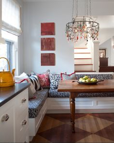 A breakfast nook can be decorated in so many ways! Add fun pillows and cushions to give a kitchen character and color. Even a chandelier over your dining space!