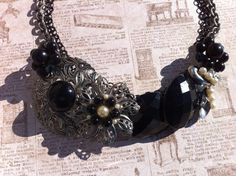 Vintage Black & Silver Bib Necklace!  Made from vintage earrings and pins, these are one of a kind necklaces.    Check it out at glamtiquing.etsy.com