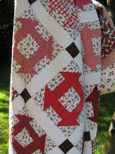 Cherry Quilt by lollyquiltz. No pattern link but it is a Churn Dash pattern with lattice