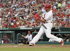 Kolten Wong connects for a two-RBI double in the second inning of a game against the Pittsburgh Pirates. Cards won the game 5-4. 7-08-14