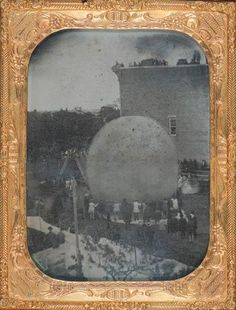 ca. 1867, A photograph of the gas balloon belonging to John Steiner is made ready for an ascension in Erie, Pennsylvania on June 18, 1857. It is the earliest photograph of an American flying machine.