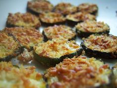 Zucchini Parmesan Crisps  ■ 2 zucchini or squash sliced 1/4in.   ■1/3 cup shredded parmesan   ■1/3 cup breadcrumbs   ■1 tsp olive oil   ■1/4 tsp salt   ■dash black pepper  Line baking sheets with foil, spray lightly with cooking spray. Toss rounds with oil. In a bowl or plate, mix breadcrumbs, parmesan, salt and pepper. Coat zuccinni w/breadcrumb mixture, pressing to adhere. Place rounds on baking sheets. Bake @ 400* / 22 to 27 minutes, until golden brown. DO NOT flip during baking.