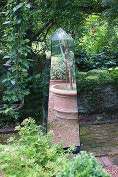 """Mirrored obelisk in the garden - photo taken by KarlGercens.com ("""",)"""