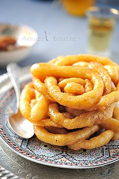 Zlabias -similar to funnel cakes, but with yeast and drenched in honey syrup.