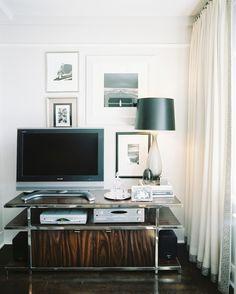 Framed art surrounding a TV.